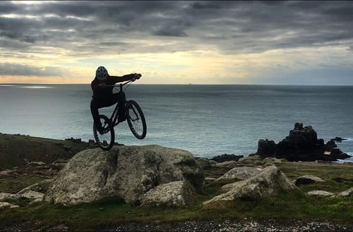 Cornish pro rider Rich Pearson rock-hopping at Land's End - photo © Rich Pearson - Heatsink Bikes - Dewerstone