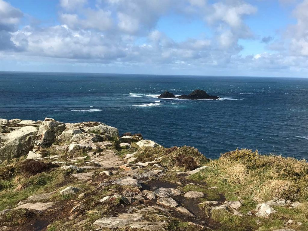 Peaceful dark blue sea at National Trust's Cape Cornwall