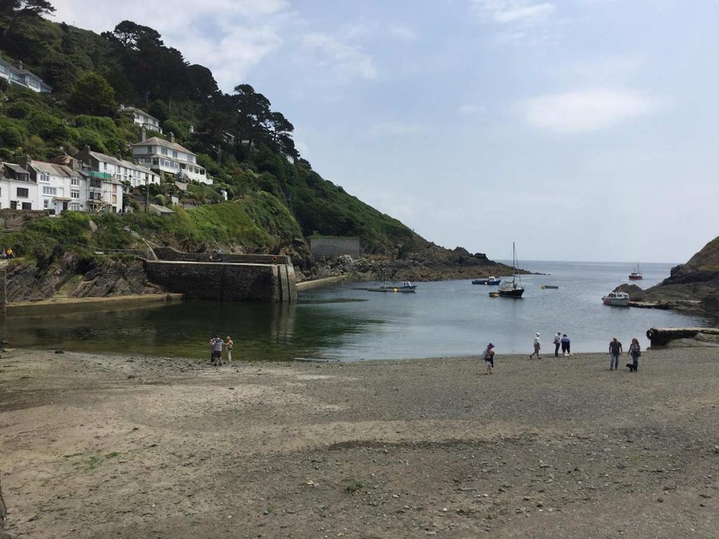 Blue skies and blue waters at the beach at Polperro