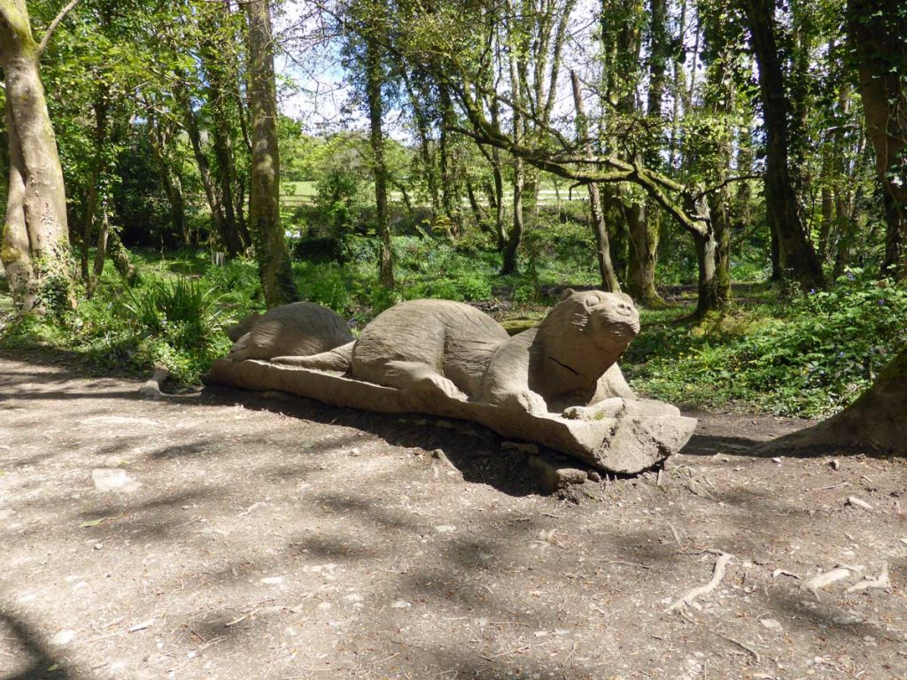 Carving of two otters (Lutra lutra) at Otter bridge, Tehidy Country Park.